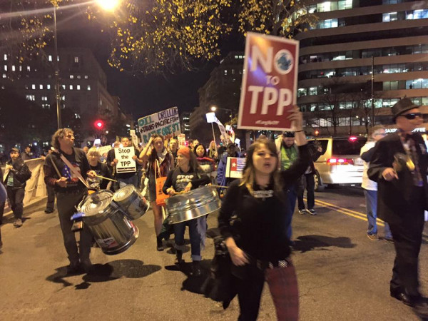 Bill leads drumming for a march against the TPP.