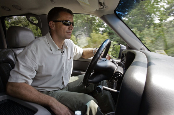 Erik Prince, then-CEO of Blackwater Worldwide, drives through campus where he could conduct training in Moyock, N.C. in 2008. Photo: Gerry Broome/AP