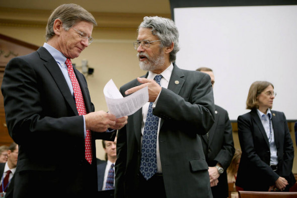 Rep. Lamar Smith, speaking here with John Holdren, director of the White House Office of Science and Technology Policy under President Barack Obama, strongly opposed the Obama administration's efforts to reduce power plant emissions. Credit: Chip Somodevilla/Getty Images