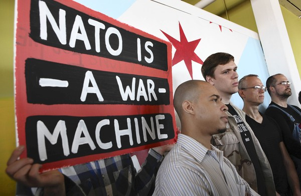 Members of various groups planning to protest the NATO summit including Jesse McAdoo, from the People's Summit, Aaron Hughes from Iraq Veterans Against the War and Andy Thayer, protest organizer talk to the media Thursday, May 10, 2012, in Chicago. By Nancy Stone for the Chicago Tribune.