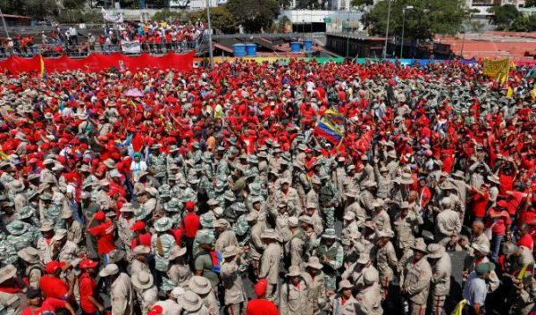 rally in support of maduro and in celebration of the 20th anniversary of election of hugo chavez reuters. e1549220160364