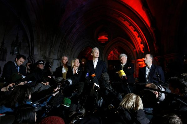 assange on steps of high court in london december 2010. photo by stefan wermuth for reuters. e1555262002872