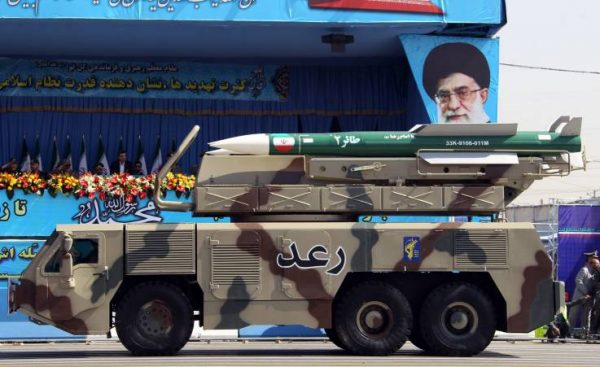 https://popularresistance-uploads.s3.amazonaws.com/uploads/2019/06/iranian-surface-to-air-missile-defense-sysetm-on-display-in-2012-at-an-iranian-military-parade.-by-ata-kenare-for-afp-getty-images.-e1561333140125.jpg