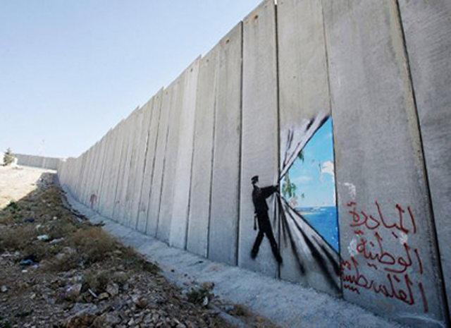 tearing a hole in israelis apartheid wall