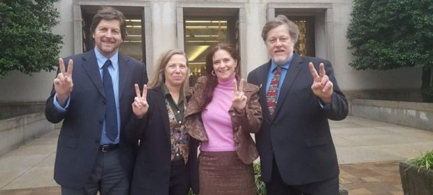 Embassy protectors [left to right: David Paul, Margaret Flowers, Adrienne Pine, Kevin Zeese] outside of court