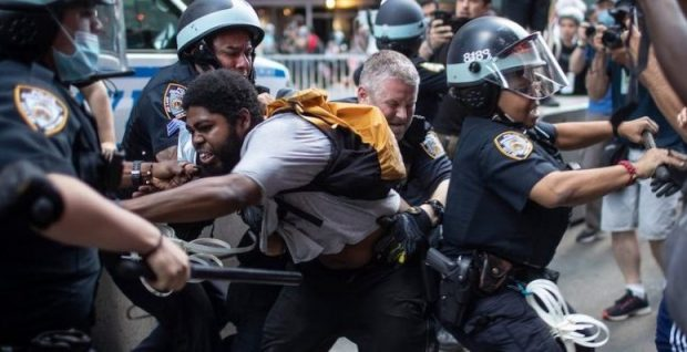protesters battle with the police from black agenda report e1592772343817